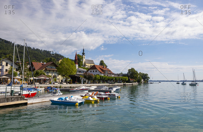 Austria- Upper Austria- Attersee am Attersee- Pedal boats moored in marina of lakeshore village in summer