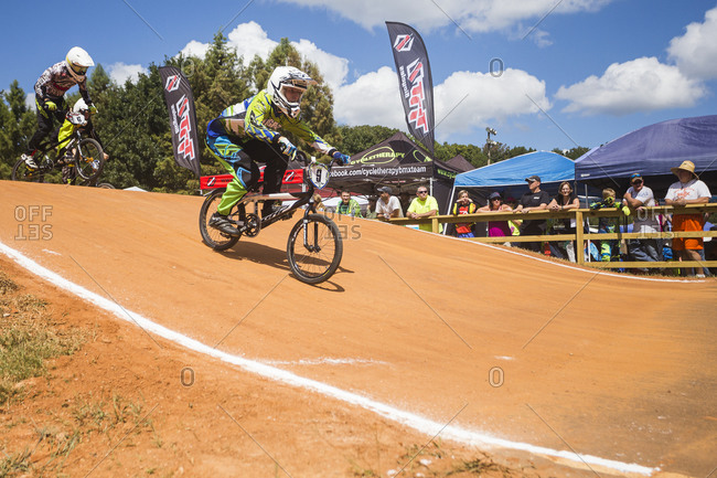 Raleigh, North Carolina - September 19, 2015: Two racers riding over hill while competing in the 2015 Tar Heel National BMX Regional Championship race