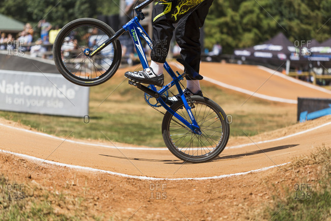 Raleigh, North Carolina - September 19, 2015: Racer popping a wheelie while competing in the 2015 Tar Heel National BMX Regional Championship race