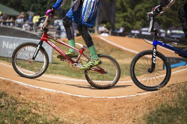 Raleigh, North Carolina - September 19, 2015: Low section of racers competing on track in the 2015 Tar Heel National BMX Regional Championship race