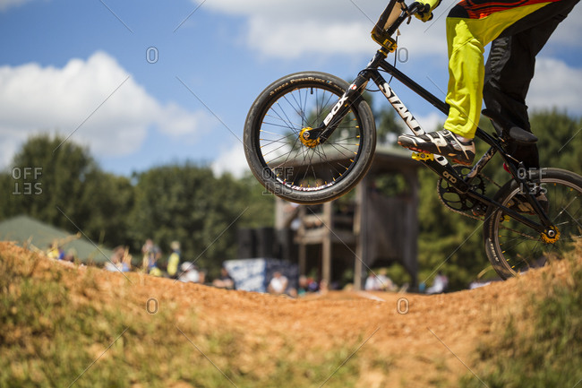 Raleigh, North Carolina - September 19, 2015: Focus on low-section of a racers popping a wheelie on bike in the 2015 Tar Heel National BMX Regional Championship race