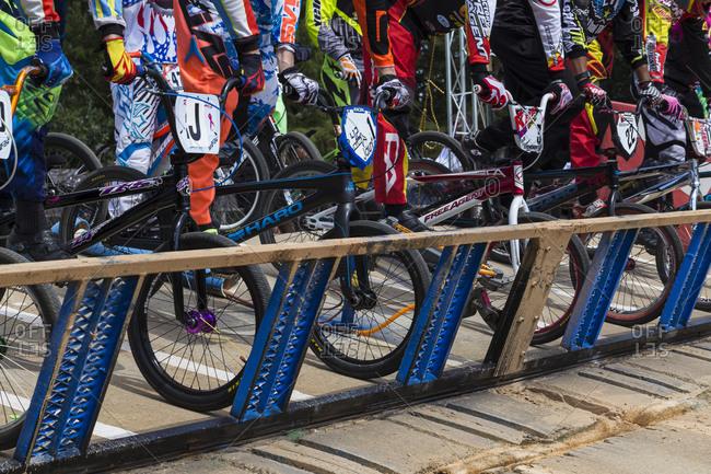 Raleigh, North Carolina - September 19, 2015: Racers on platform before starting race in the 2015 Tar Heel National BMX Regional Championship race