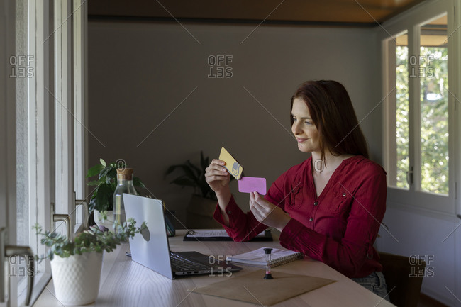 Psychologist showing paper on video call while sitting at home