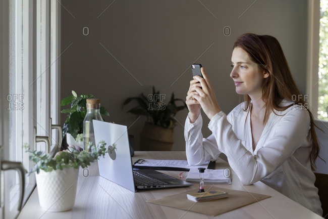 Psychologist using mobile phone while sitting at home