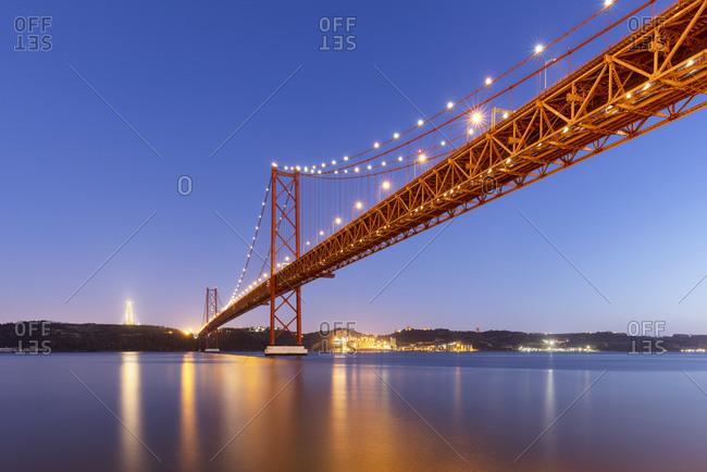 Portugal- Lisbon District- Lisbon- 25 de Abril Bridge at dusk