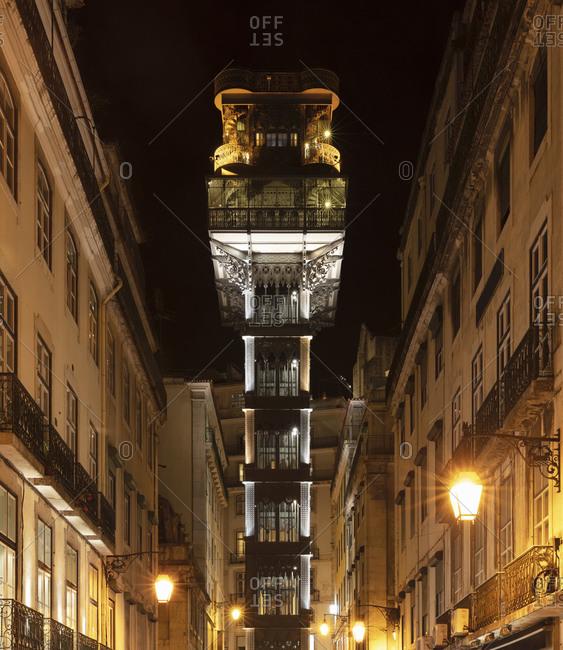 Portugal- Lisbon District- Lisbon- Illuminated Santa Justa Lift at night