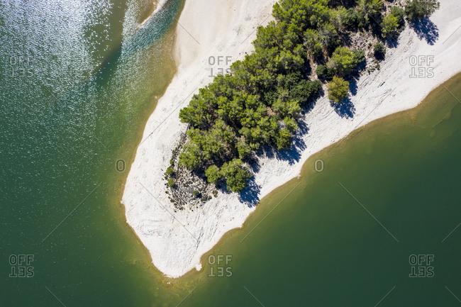 Spain- Balearic Islands- Helicopter view of sandy beach of Gorg Blau reservoir in summer