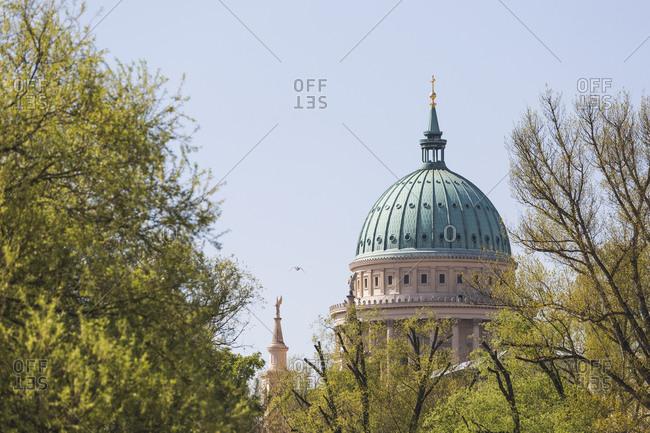 Germany- Brandenburg- Potsdam- Trees against dome of Saint Nicholas Church