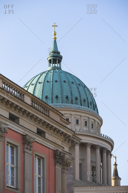 Germany- Brandenburg- Potsdam- Dome of Saint Nicholas Church behind roof of residential building