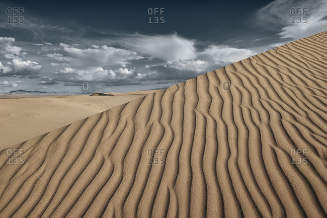 Natural wave pattern on Cadiz Dunes against sky at Mojave Desert- Southern California- USA
