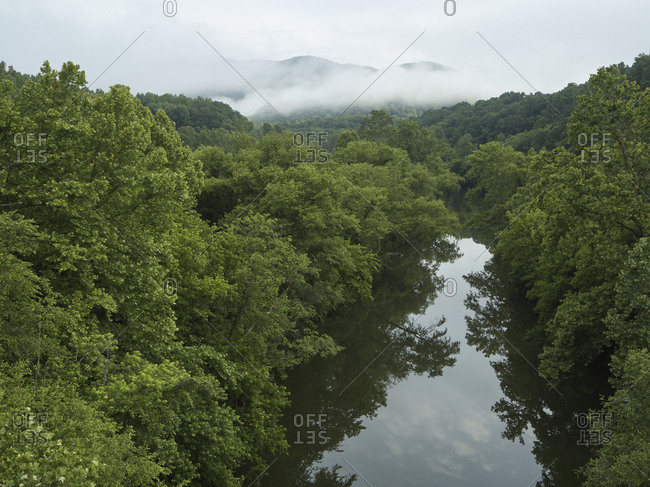 Drone view of Cumberland River surrounded by green lush forest