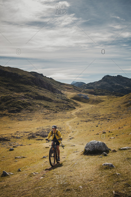 Woman riding electric bicycle on mountain at Somiedo Natural Park- Spain