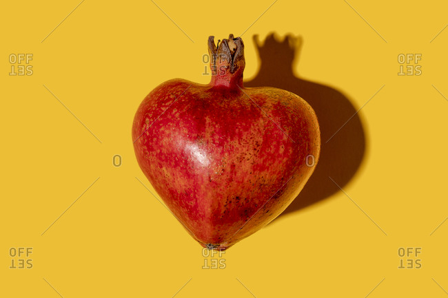 Studio shot of heart shaped pomegranate