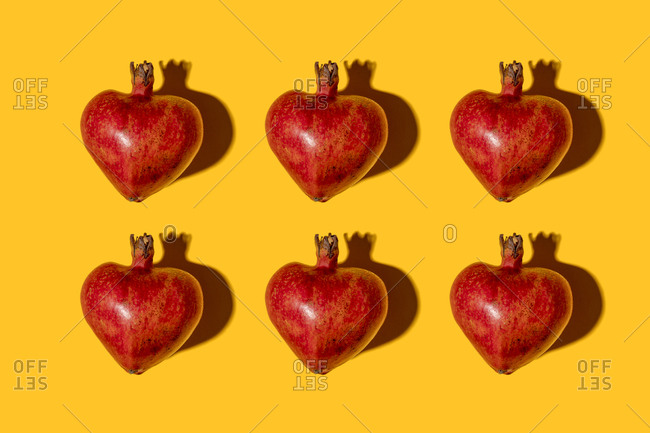Studio shot of heart shaped pomegranates