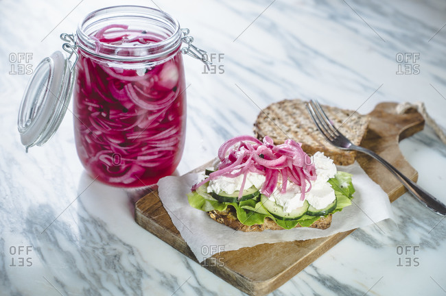 Sandwich with pickled onions- cucumbers- creamed goat cheese and lettuce
