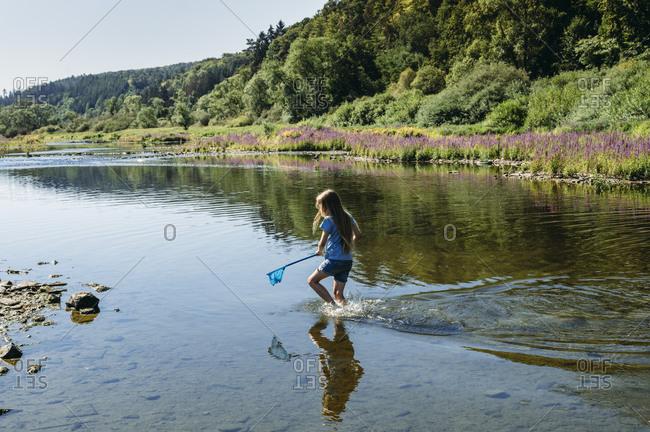 Little girl fishing in the Edersee reservoir