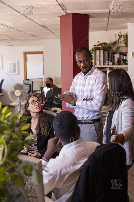 Multi-ethnic business professionals brainstorming during meeting in office