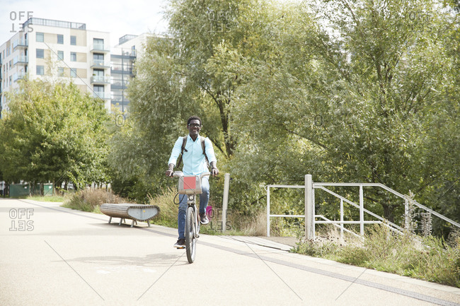 Man commuting on bicycle in city