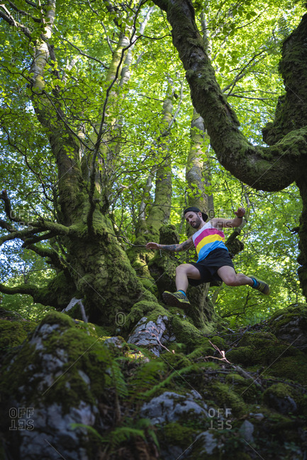 Trail runner running in a beautiful open forest