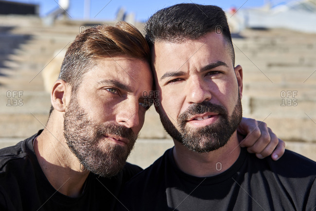 Handsome gay couple spending leisure time together