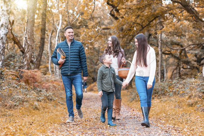 Happy family walking in Cannock Chase park during autumn
