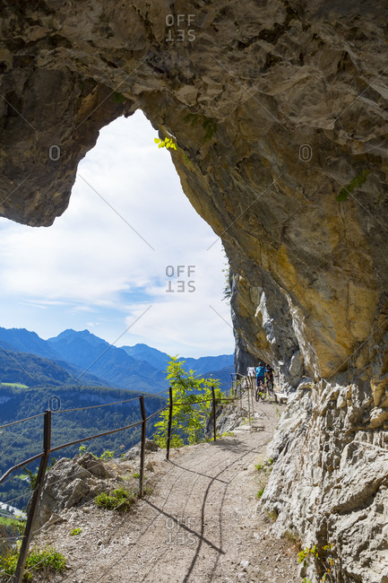 Mountain bikers cycling on mountain path of Ewige Wand at Bad Goisern- Upper Austria- Austria