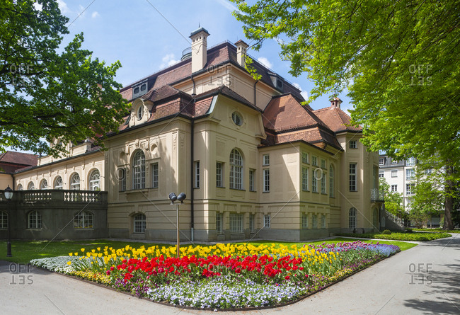 Germany- Bavaria- Bad Reichenhall- Colorful flowerbed in front of spa in Royal Spa Garden