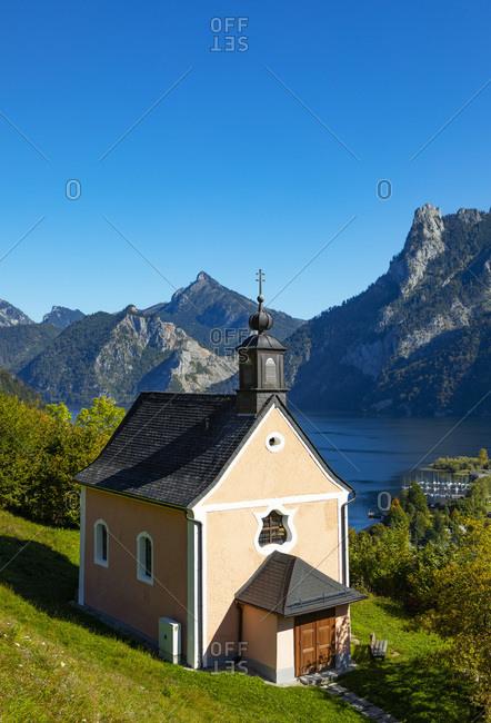 Austria- Upper Austria- Ebensee- Kalvarienbergkirche overlooking alpine town in summer
