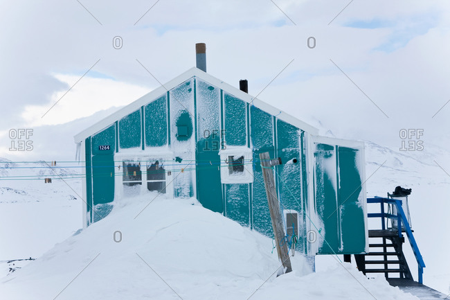 January 8, 2021: House in winter covered in snow, Tasiilaq, south eastern Greenland