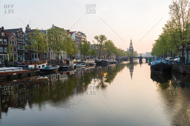 January 8, 2021: The Oudeschans canal in Amsterdam with the Montelbaanstoren tower in the background, Netherlands