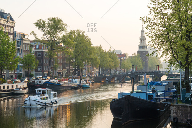 January 8, 2021: The Oudeschans canal in Amsterdam and the Montelbaanstoren tower, Netherlands
