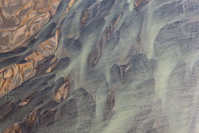 Aerial view of Hosa river colored by glacial melt, SW Iceland