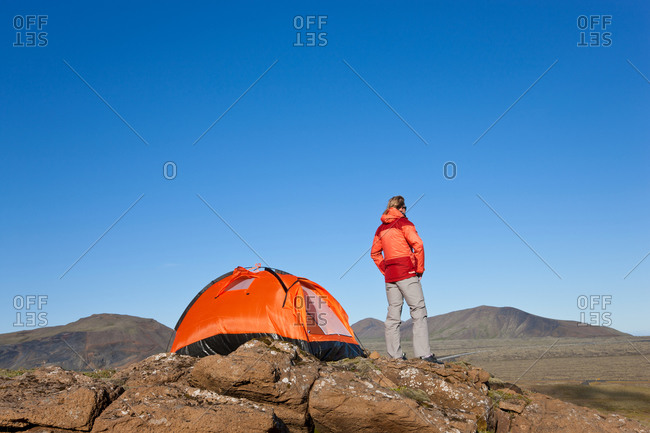 Woman standing by tent, Iceland