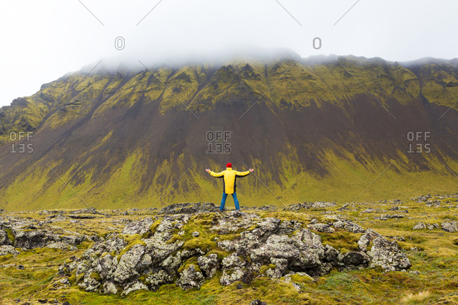 Man standing on rocks, Snaefellsnes peninsula, West Iceland