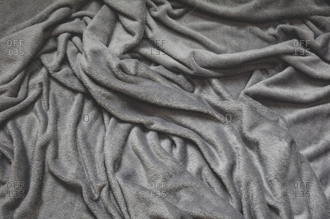 Detail of crumpled grey velvet fabric