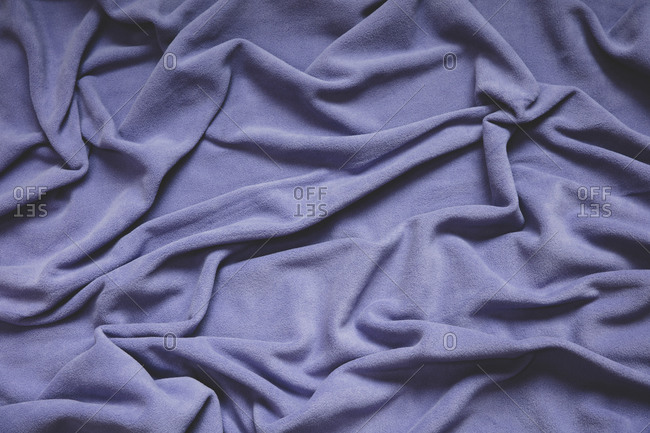 Detail of crumpled fleece blanket, focus in folds and creases