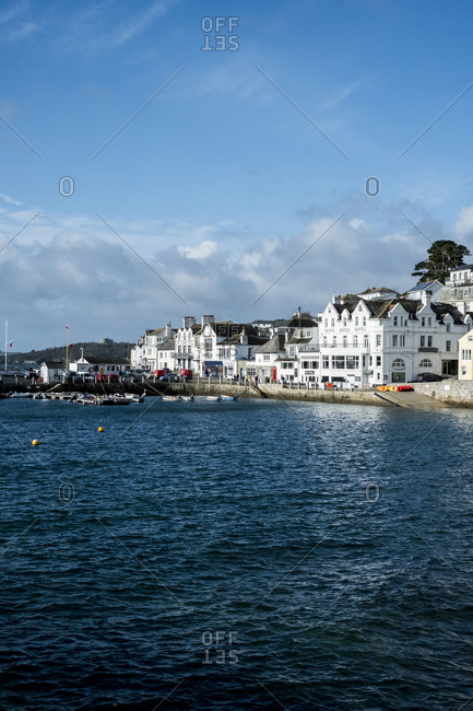 January 8, 2021: View along the seawall and facades of houses in Saint Mawes, Cornwall, UK.