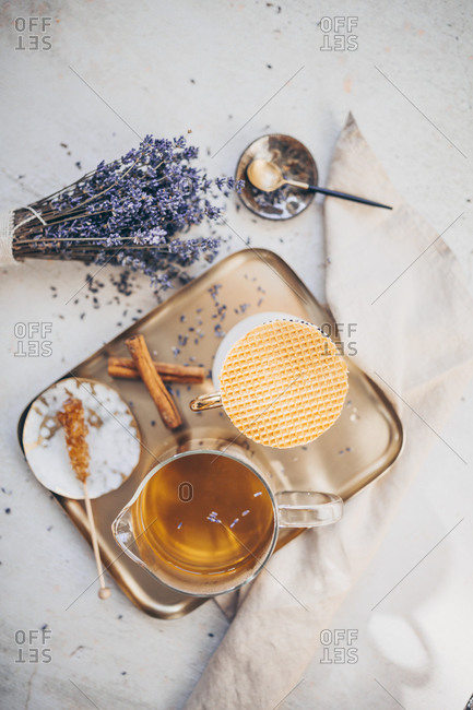 Tea set on a tray served with lavender and cinnamon viewed from above