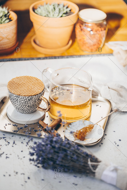Front view of tea in a set on a tray served with lavender and cinnamon