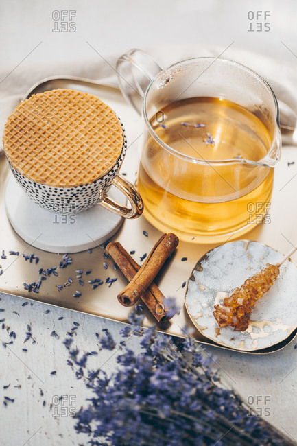 Tea in a set on a tray served with lavender and cinnamon