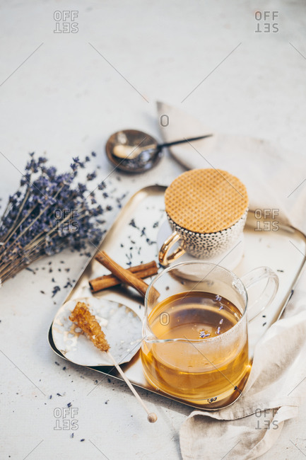 Tea set on a tray served with lavender and cinnamon