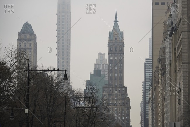 Old skyscrapers on background of cloudy sky in Manhattan in New York