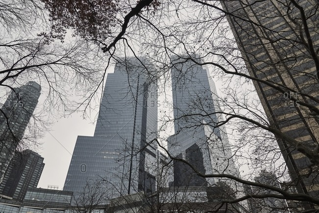 December 15, 2018: Low angle of modern skyscrapers on background of cloudy sky in Manhattan in New York