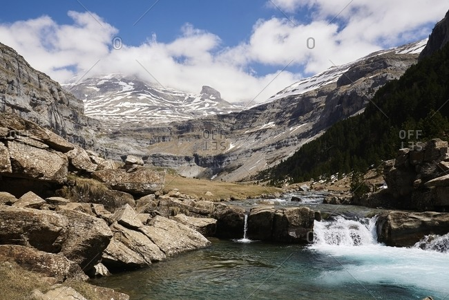 View of amazing cascade waterfall in Pyrenees mountain range in Ordesa Valley