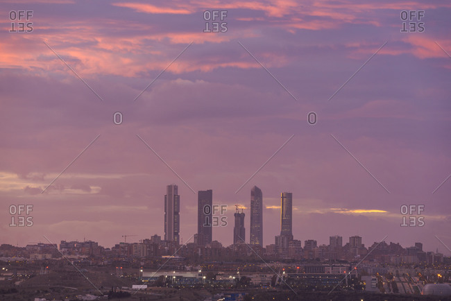 Amazing view of Cuatro Torres business area with skyscrapers under sundown sky in Madrid