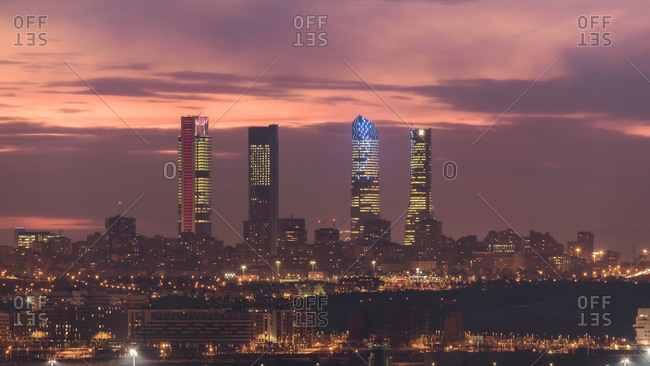 February 28, 2019: Amazing view of Cuatro Torres business area with skyscrapers under sundown sky in Madrid
