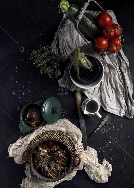 Top view composition with aromatic vegetarian dish ratatouille in pan placed on table with fresh vegetables