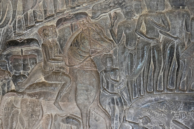 Angkor Wat, Cambodia, Asia - December 28, 2019: Bas-relief of cavalry on the walls of Angkor Wat