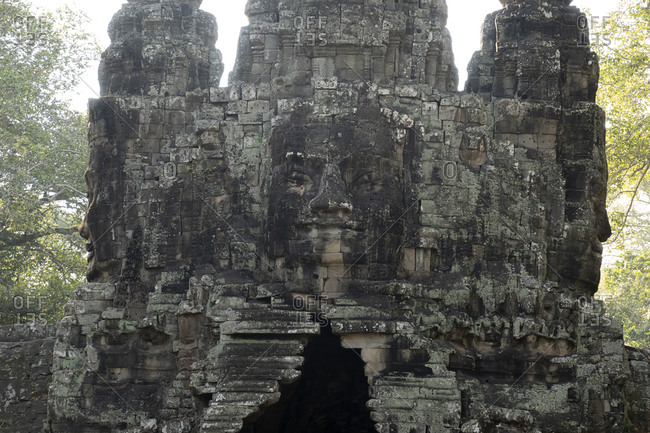 Large face carved into the wall of a temple in Angkor Thom