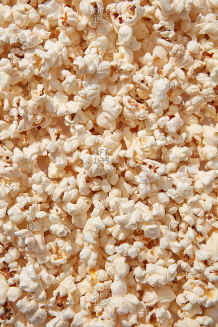 Closeup of appetizing cooked salty popcorn, top view